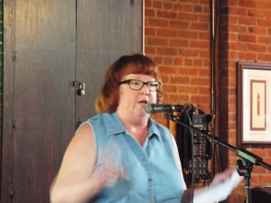 Dianne Borsenik during her award winning performance in the Best Cleveland Poem Competition held 1 June 2014 at the Willoughby Brewing Company [photo by John Burroughs]